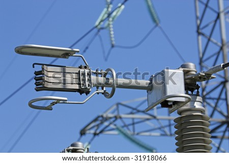 Electric main and unusual insulators on it - stock photo