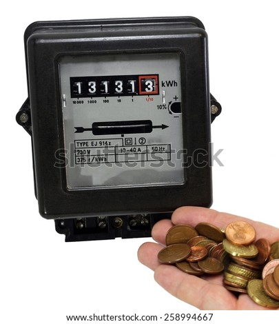 electric meter and the hand full of European currencies - stock photo