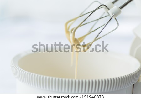 electric mixer with a dough with beaten - stock photo