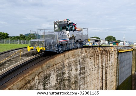 Electric mule engine guides ships through the Miraflores Locks Panama Canal - stock photo