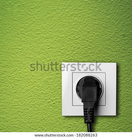 Electric outlet with cable plugged - stock photo
