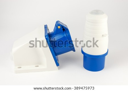 Electric plastic power plug and wall socket with cap isolated on white background - stock photo