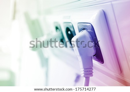 Electric plug in a socket - stock photo
