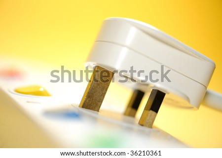 electric plug on a yellow background - stock photo