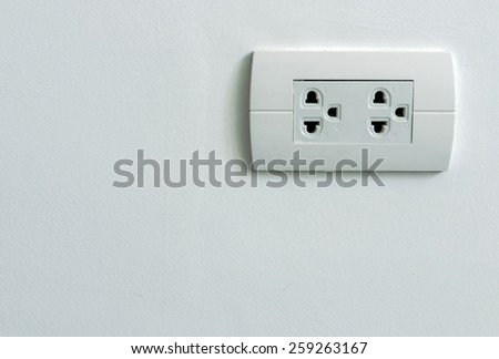 electric plug on wall - stock photo