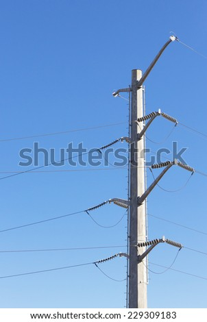 Electric pole in blue sky background - stock photo
