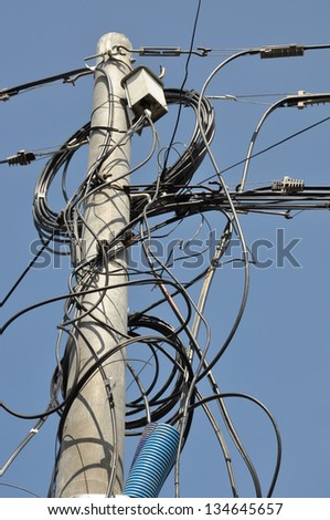 Electric pole with lines of cables - stock photo