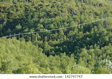 Electric power line on mountins in Norway, Lofoten  - stock photo
