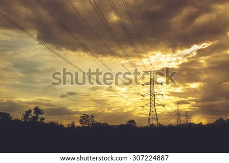 Electric power line with colorful sky at sunset - Vibrant color effect - stock photo