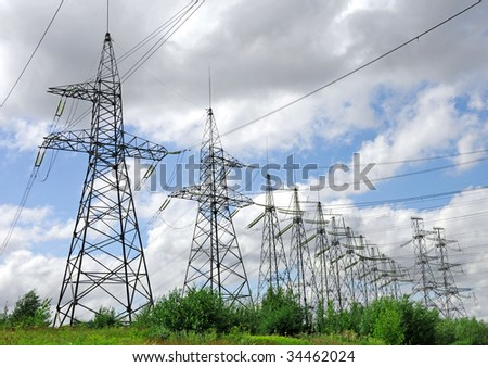 Electric power lines on a blue sky background Electrical tower on a background of the blue sky - stock photo