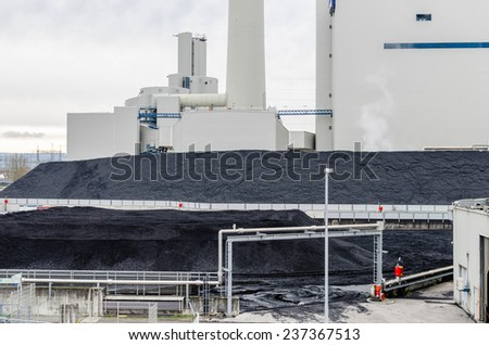 Electric power plant with coal - stock photo