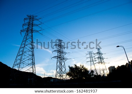 Electric power station against bright sky. - stock photo
