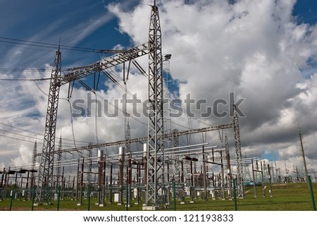 Electric power station in the countryside against a cloudy sky - stock photo