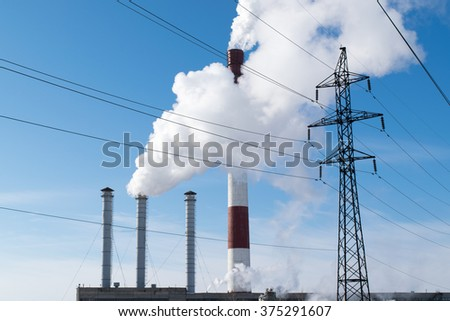 Electric power station with smokestacks - stock photo