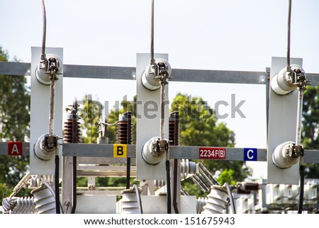 Electric power substation, high-voltage support - stock photo