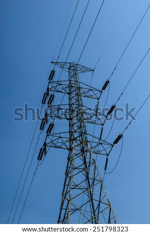 Electric power transmission or power grid pylon wires. - stock photo