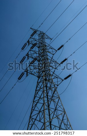 Electric power transmission or power grid pylon wires, transmission tower. - stock photo