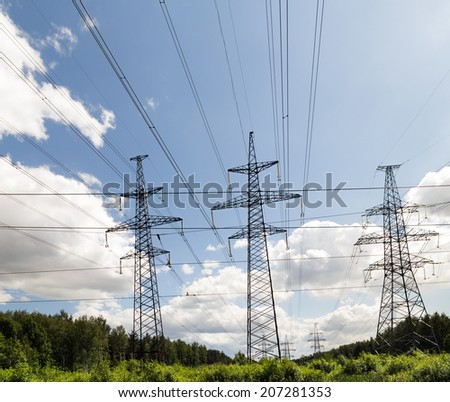 Electric powerlines on nature background - stock photo