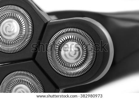 Electric shaver closeup on white background - stock photo