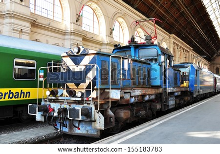 Electric shunting locomotive pushing a fast train on the platform in Budapest Keleti railway Station,Hungary. - stock photo