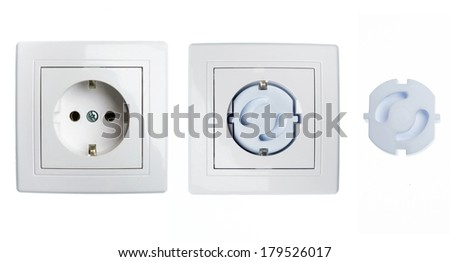 Electric socket and electric socket child protection on white background - stock photo