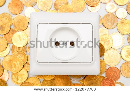 Electric socket on gold coins. - stock photo