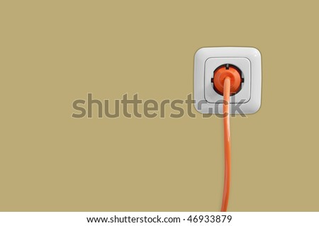 Electric socket with connected cable - stock photo