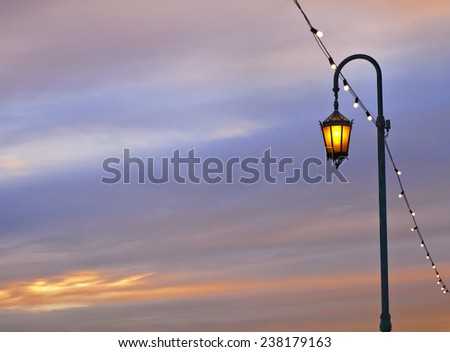 Electric Street lamp at a lake Merritt in Oakland, sky with clouds at the sunset - stock photo