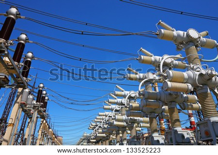 Electric substation in a bright sunny day - stock photo