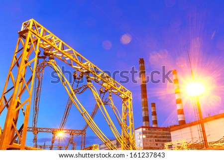 Electric substation in night-time lighting - stock photo