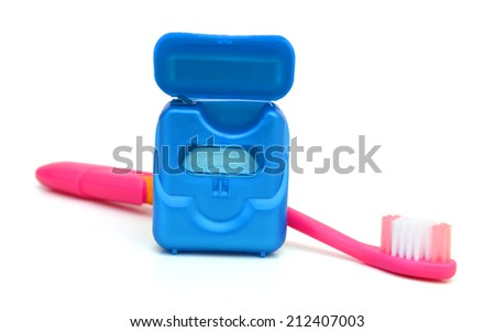 Electric toothbrush and idental floss.  - stock photo