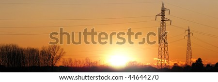 electric tower silhouette for during sunset - stock photo