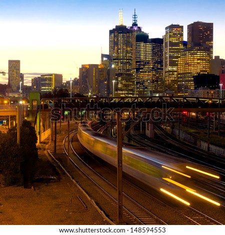 electric train at dusk heading away from Melbourne - stock photo