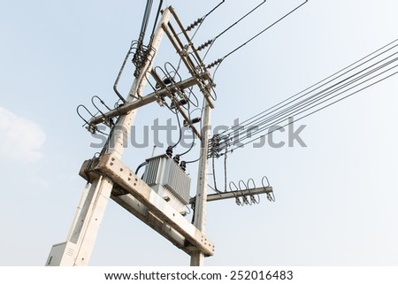 Electric transformer on electric pole - stock photo