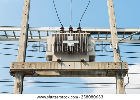 Electric transformer on the pole, Transform Electric high voltage to low voltage  - stock photo