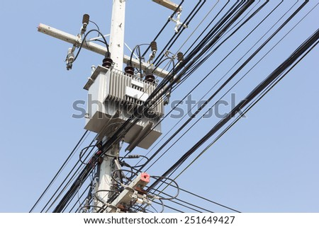 Electric transformer substation on blue sky background. - stock photo