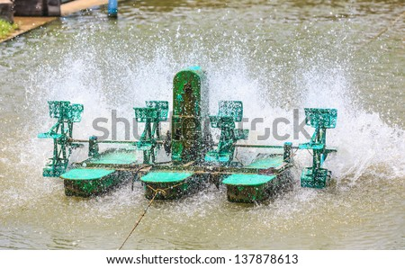 electric turbine for water treatment as an increasing oxygen in water - stock photo