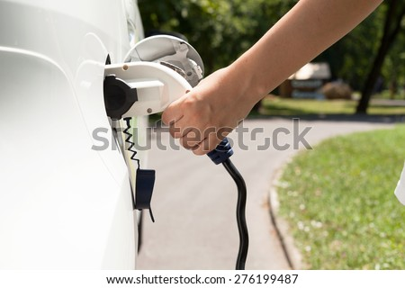 Electric vehicle charging - stock photo