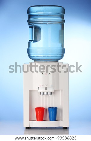 Electric water cooler on blue background - stock photo