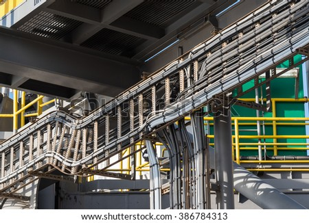 electric wire installed on tray in industrial factory - stock photo