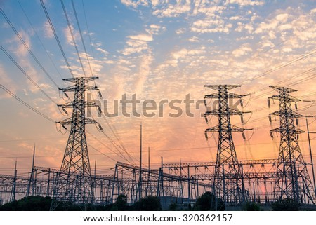 Electric wires on a column about high volt - stock photo