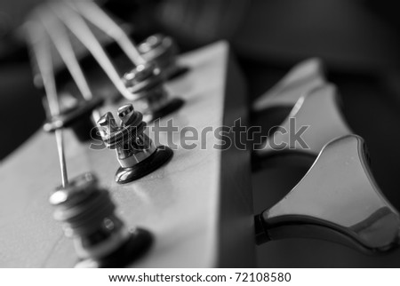 electrical bass guitar head closeup, black and white - stock photo