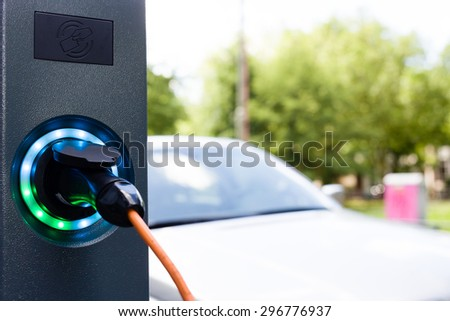 Electrical car battery charger socket with load indicator lights. Selective focus, space for copy text - stock photo