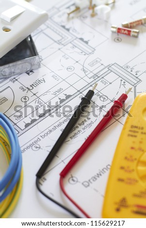 Electrical Components Arranged On House Plans - stock photo