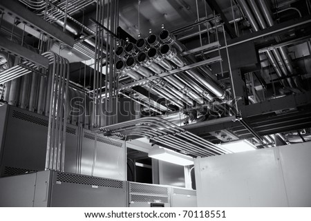 Electrical conduits for a 4000 ampere transfer switch,  black and white. - stock photo
