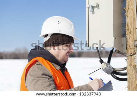 Electrical engineer inspect electric lines  technical quality - stock photo