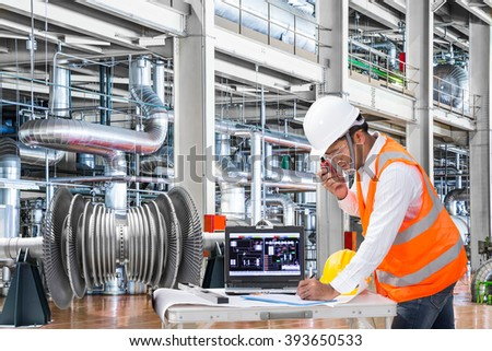 Electrical engineer working at modern thermal power plant - stock photo
