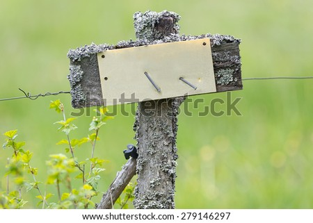 Electrical fence in old style with empty sign for own text or symbol - stock photo