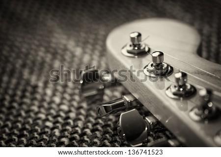 Electrical guitar head stock closeup. Sepia, vignette - stock photo
