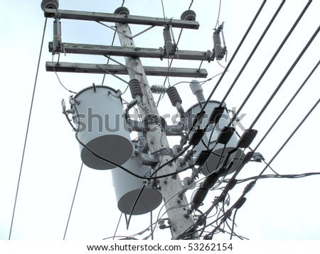 Electrical high voltage power line and electrical drums on wood pole - stock photo